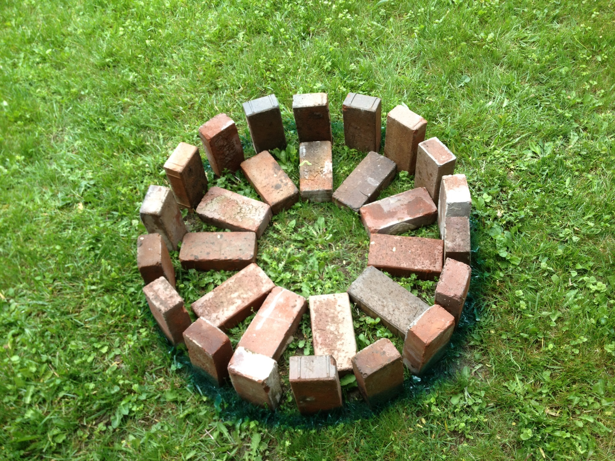 Step by step build your own fire pit the perfect garden for Brick fire pit construction